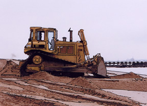 bulldozer spreads sand at Laurence Harbor, NJ
